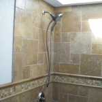 Noce French Pattern Wall Tile and Bullnose with mixed 1x1 mosaic tile.